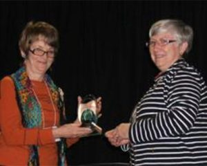 Janis Wilton receiving her award